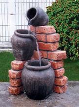 Brick Wall and Water Jug Fountain